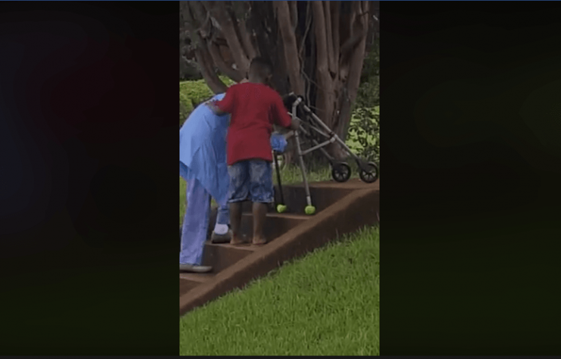 8-year-old-boy-helps-woman-across-street-and-up-stairs