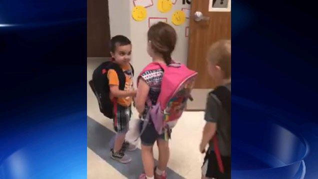 kindergartners-start-their-day-with-handshakes-hugs-and-smiles