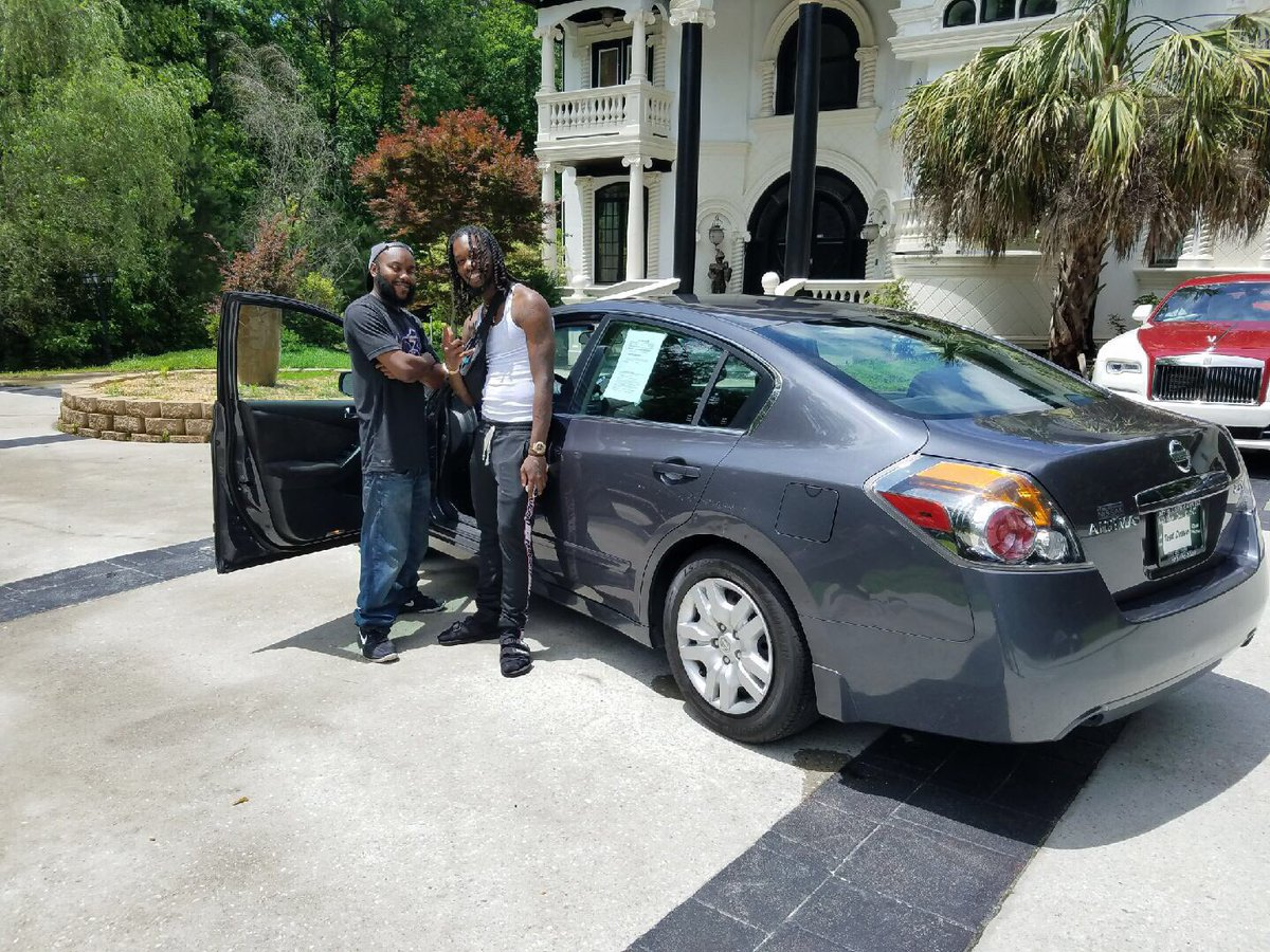 man-walking-to-work-given-new-car