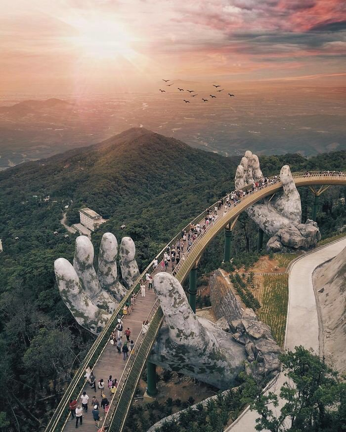 very-unique-bridge-made-of-two-gigantic-hands-holding-it