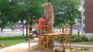 Carving A Bear Statue Out Of A Stump
