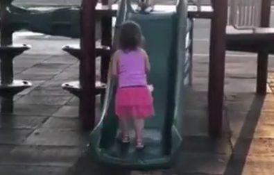 girl-teaches-her-puppy-how-to-slide