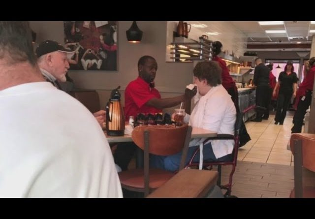 Waiter Feeds Woman Requiring Help To Eat